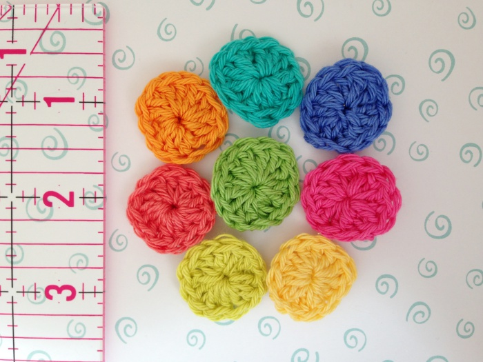 Group of finished crochet buttons in 4-ply cotton