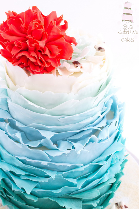 Ombré waves and coral flower cake