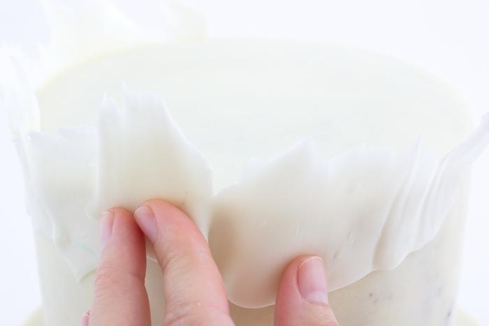 Place shaving on cake