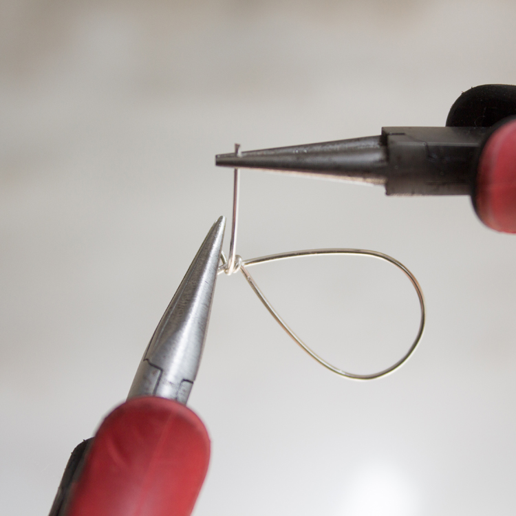 Continue bending this wire up and around the earring