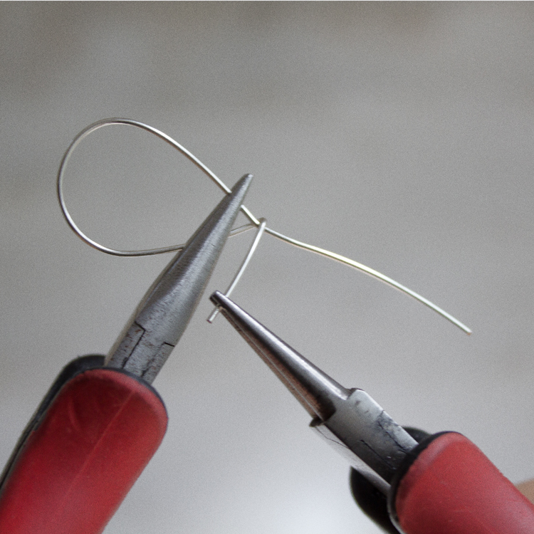 Bending the shorter wire with your needle nose pliers