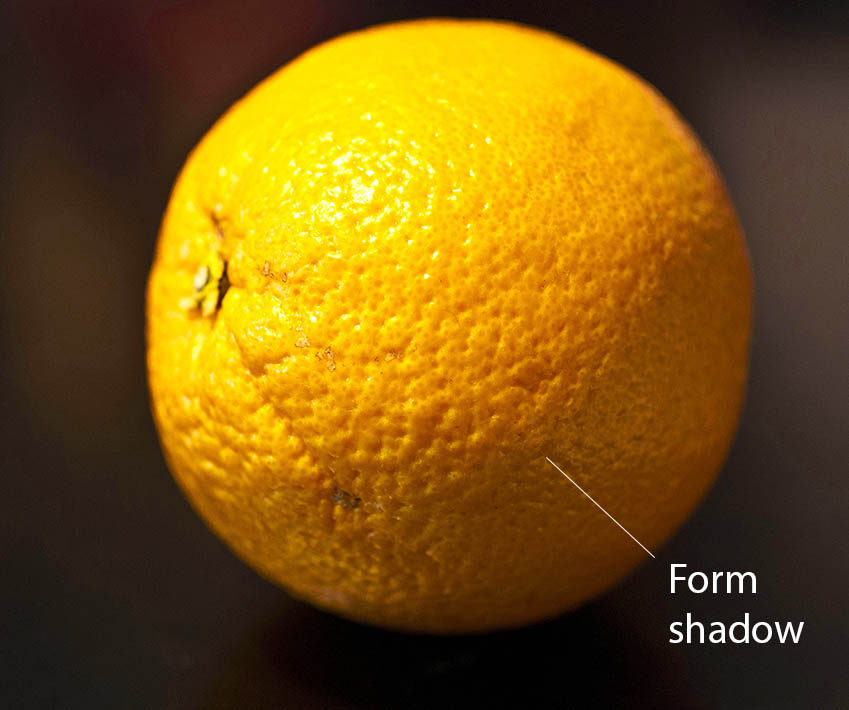 Orange under the directional light showing the form shadow.