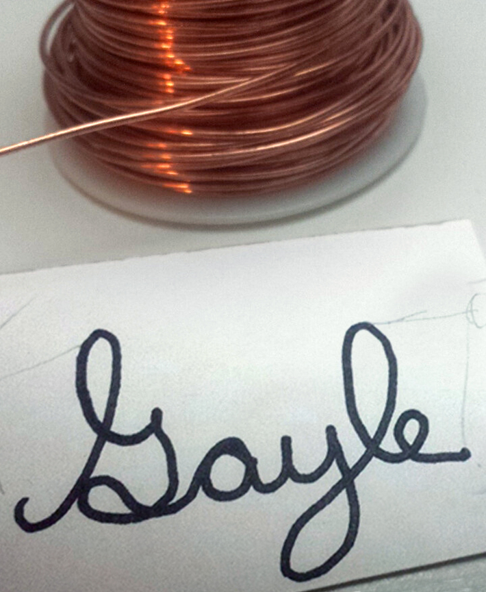 Spool of wire and template for handwriting jewelry