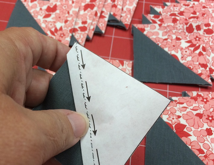Removing the papers from Triangles on a Roll