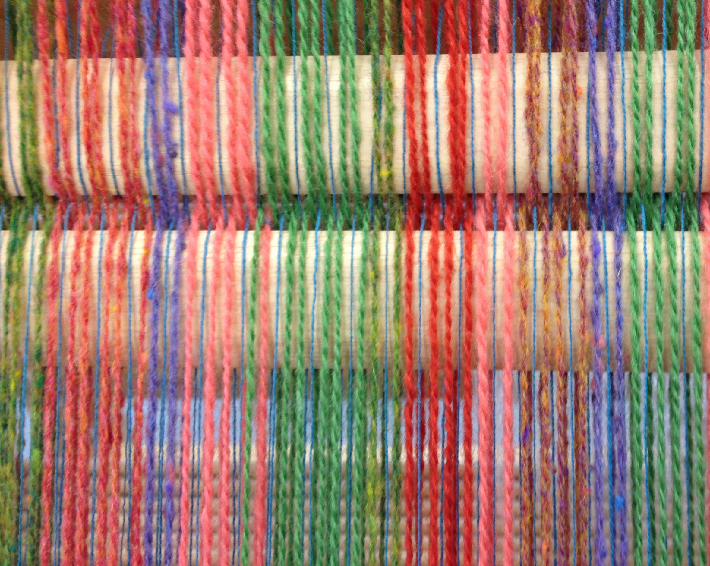 A striped warp with wool