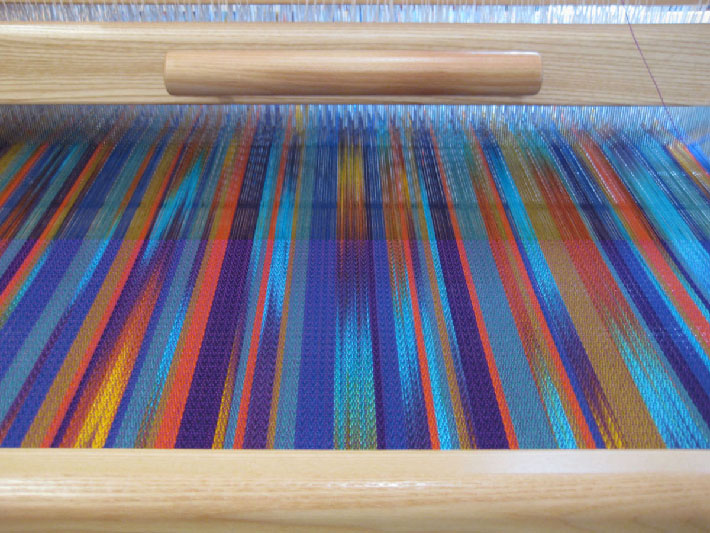 weaving with stripes of space-dyed yarn in the warp