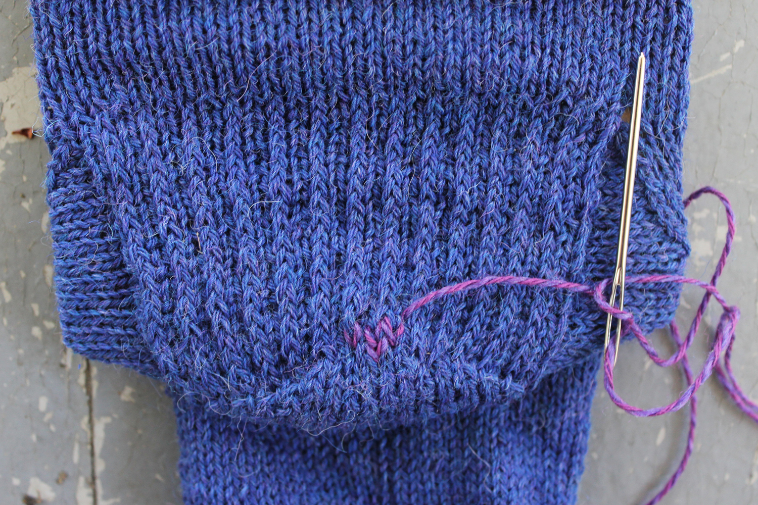 Duplicate stitch rows on a sock heel