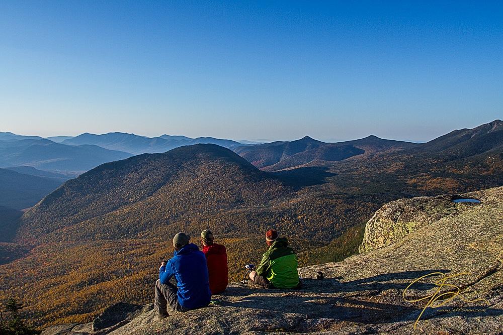 Three hikers enjoying the view over the Pemigewasset Wilderness