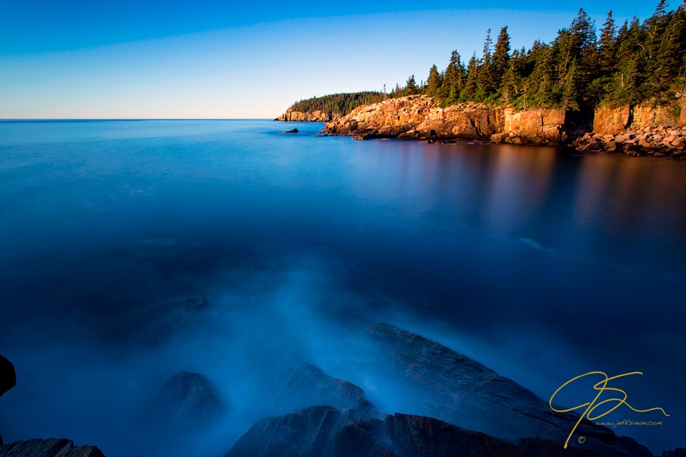 A 3 minute exposure blurs the surface of the ocean at Monument Cove in Acadia National Park