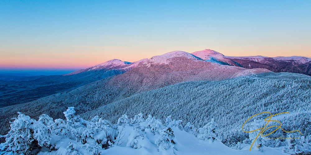 Snow covered Mount Washington bathed in alpenglow