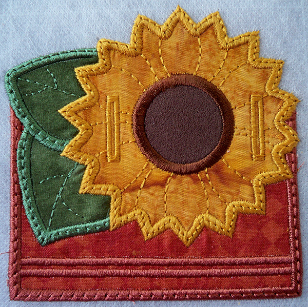 stitched sunflower in the hoop magnetic memo holder