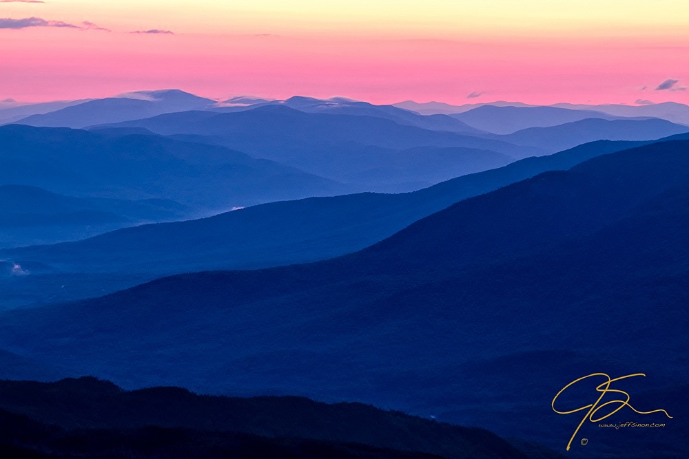 Mountains in the distance in pastel pink and blue layers
