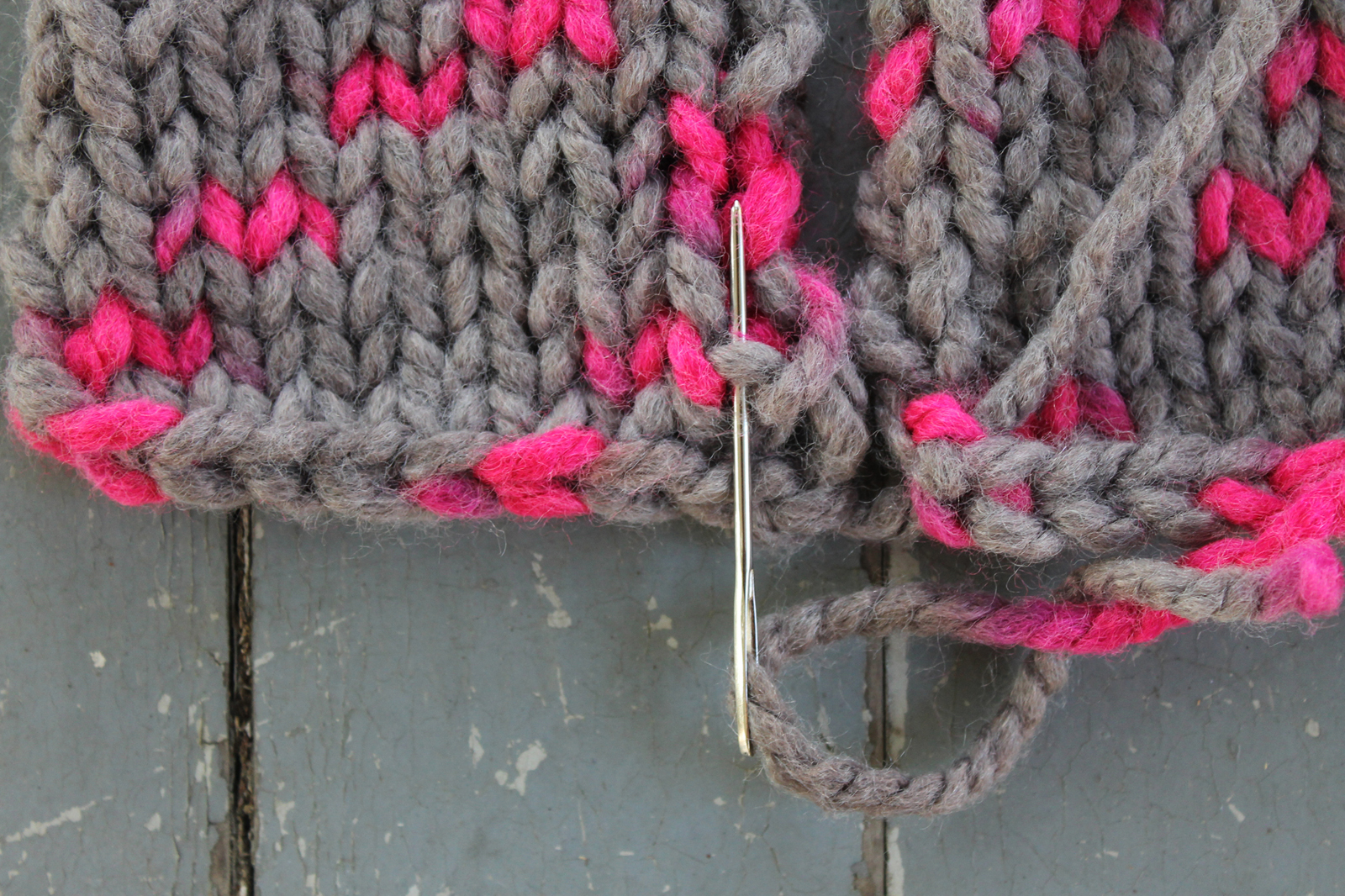 Inserting the yarn needle into the first ladder stitch