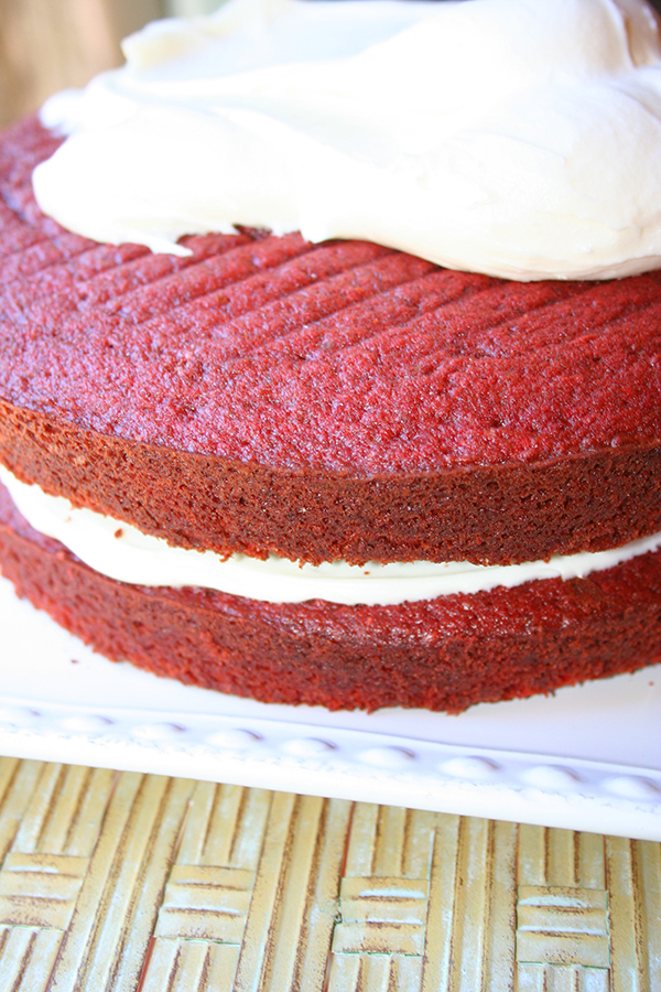 Ice the red velvet cake