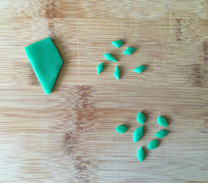 cutting green candy leaves