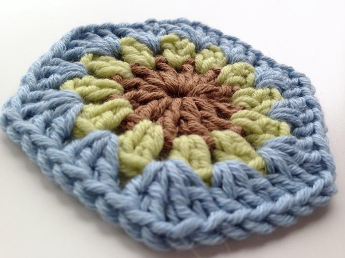 Flower centre crochet hexagon motif completed