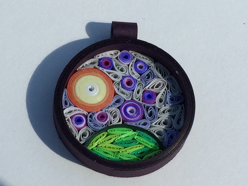 Quilled background pendant