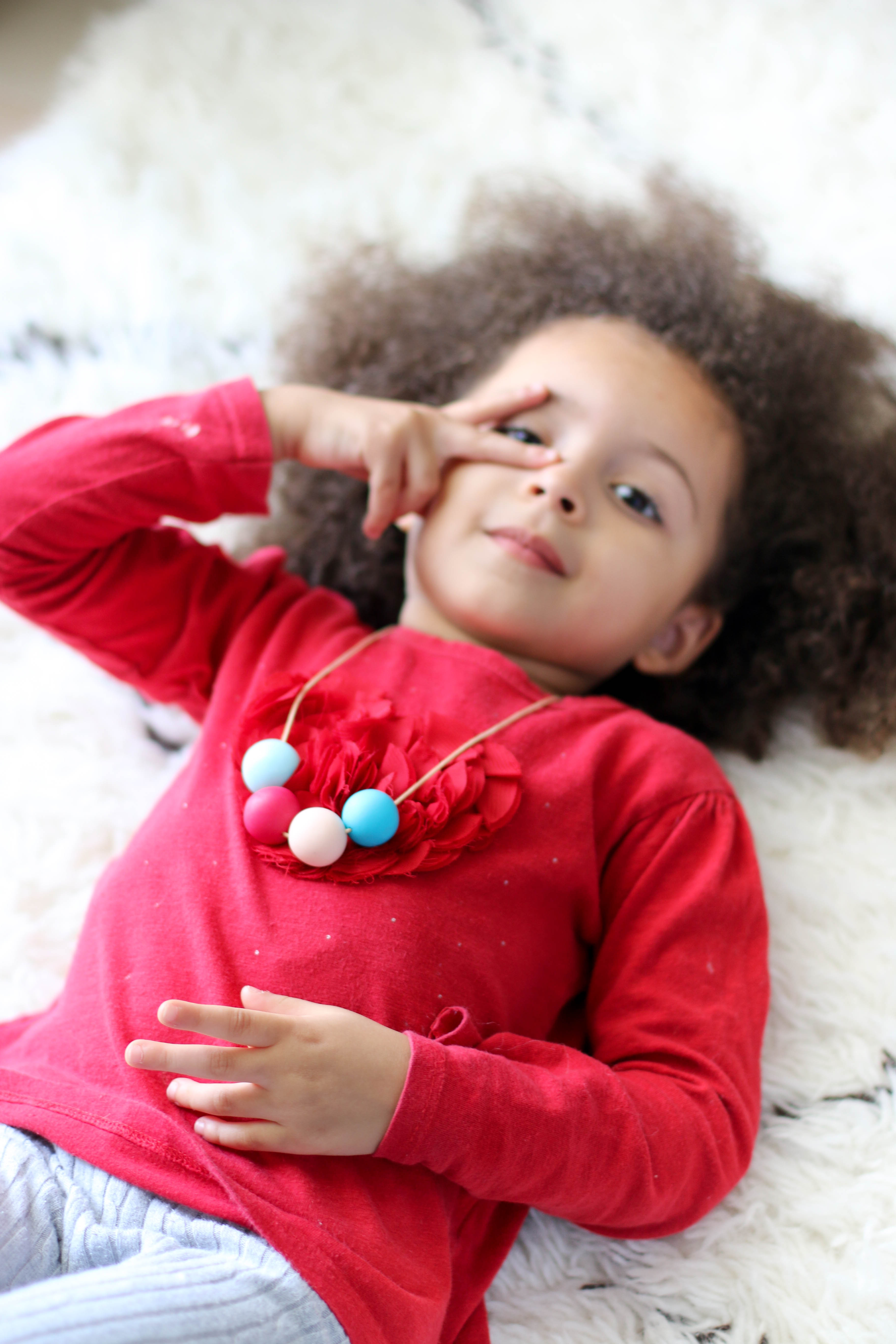 Child Wearing a Polymer Clay Necklace