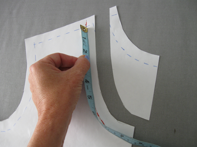 example of how to measure neckline using measuring tape