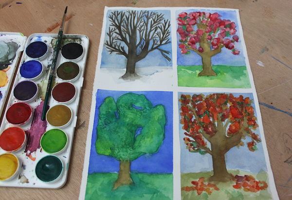 When painting trees in watercolor, their appearance will change based on the time of year.