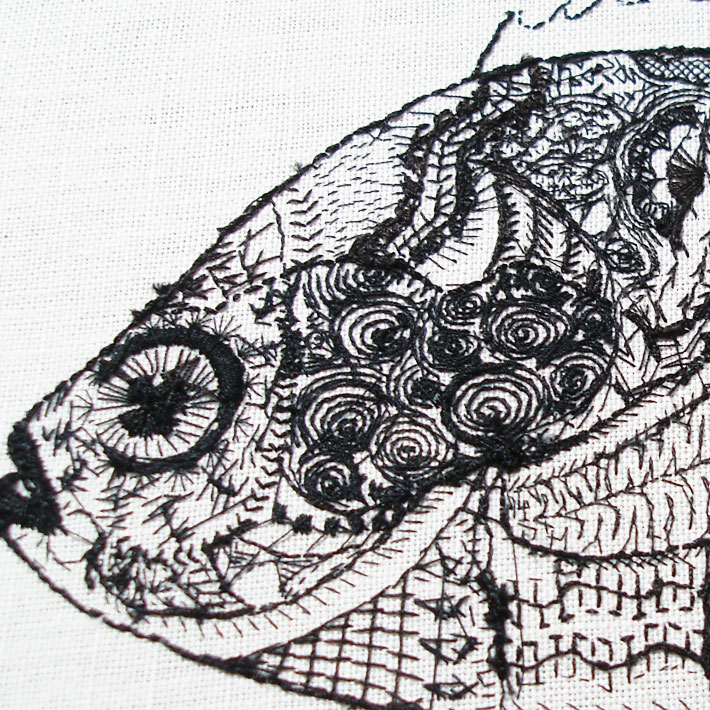 the back of an embroidery project