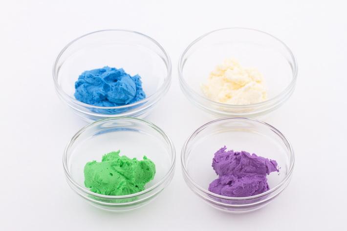 Four bowls colored buttercream