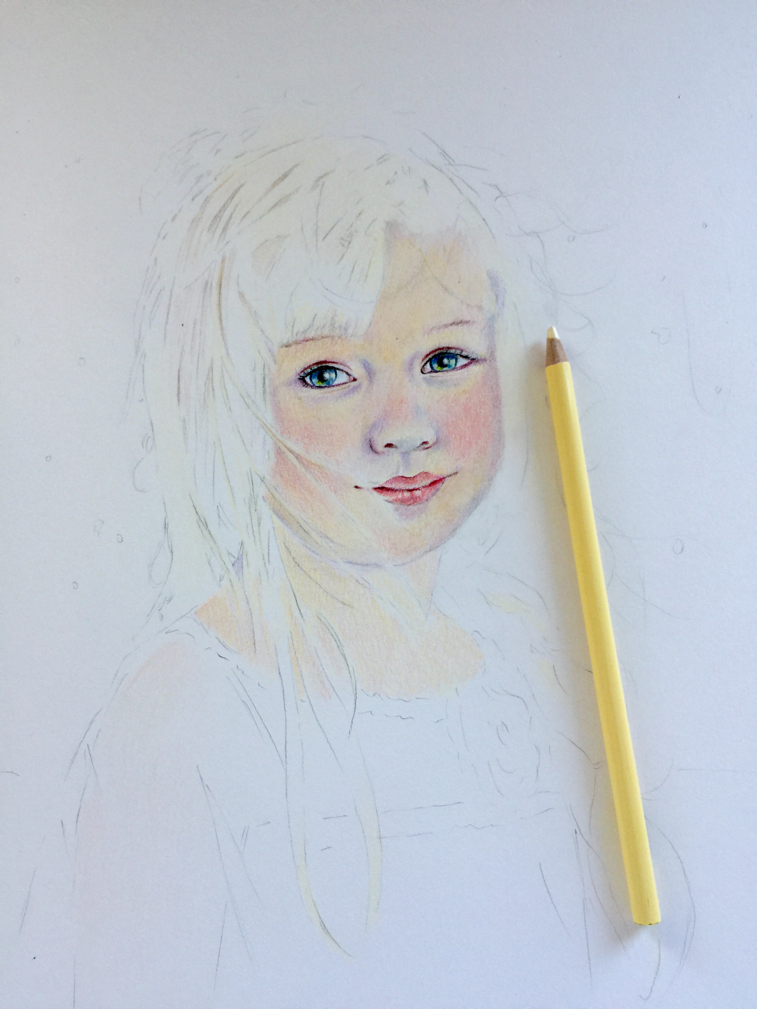 Adding flesh tones to a colored pencil portrait