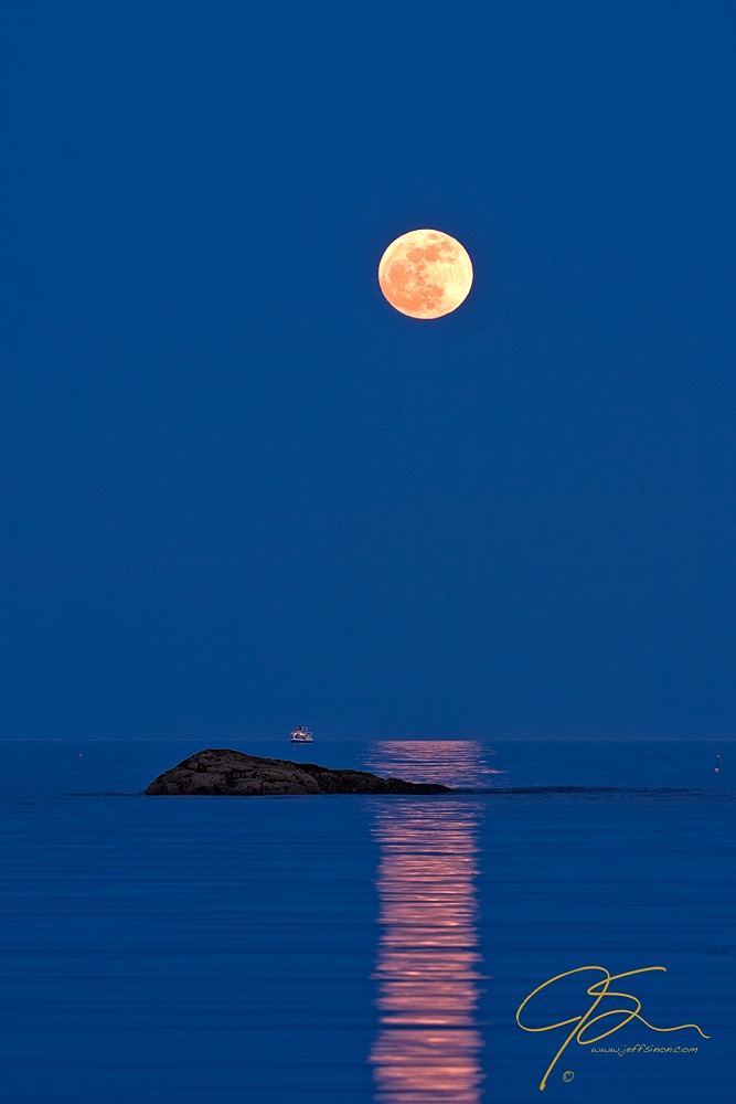 Super Moon over the New Hampshire seacoast with cruise ship near the horizon