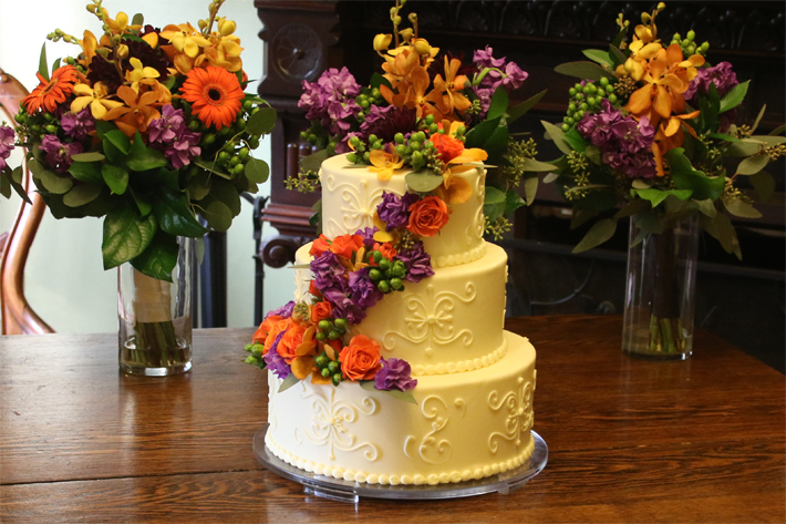 Photograph of wedding cake and flowers