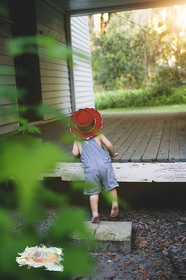 curious toddler boy red hat
