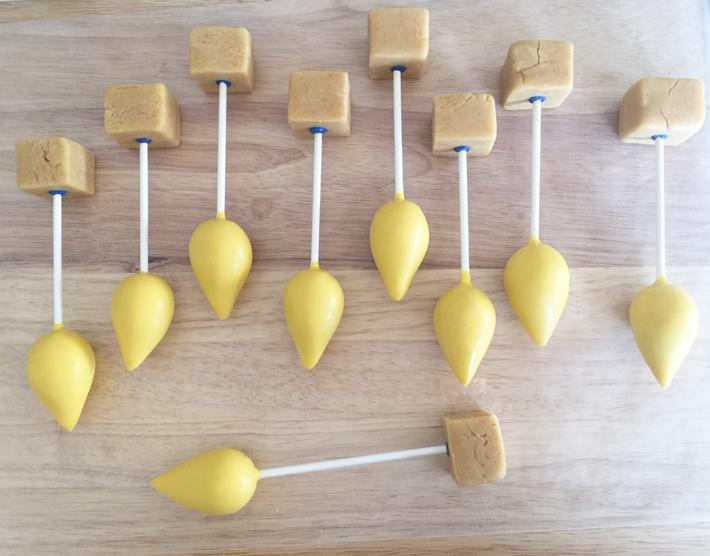 Adding bases to menorah cake pops