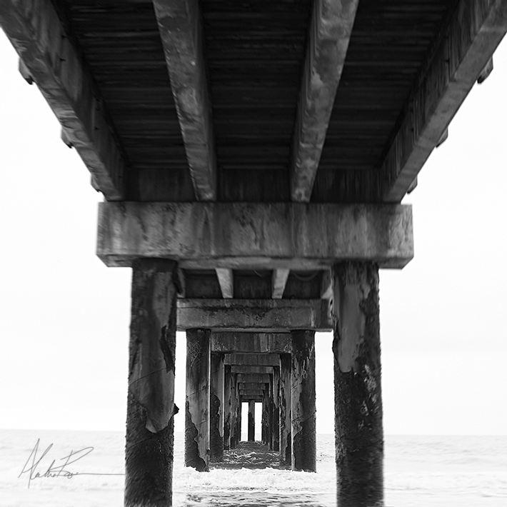 beach pier black and white