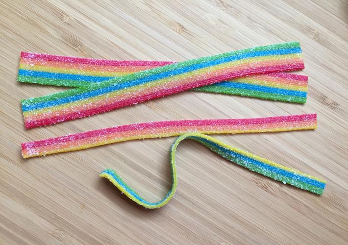 Sour belts cut lengthwise