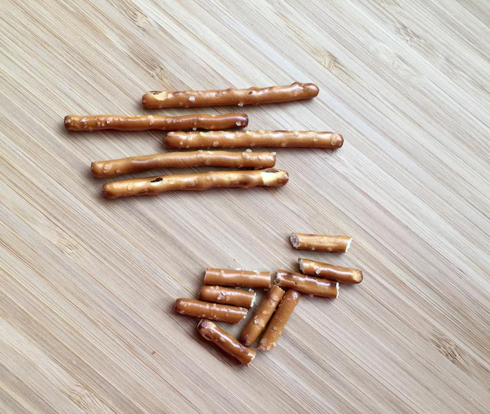 Break pretzels into pieces