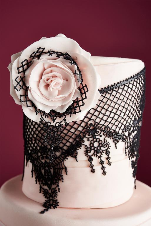 Elegant edible lace cake with pink sugar rose