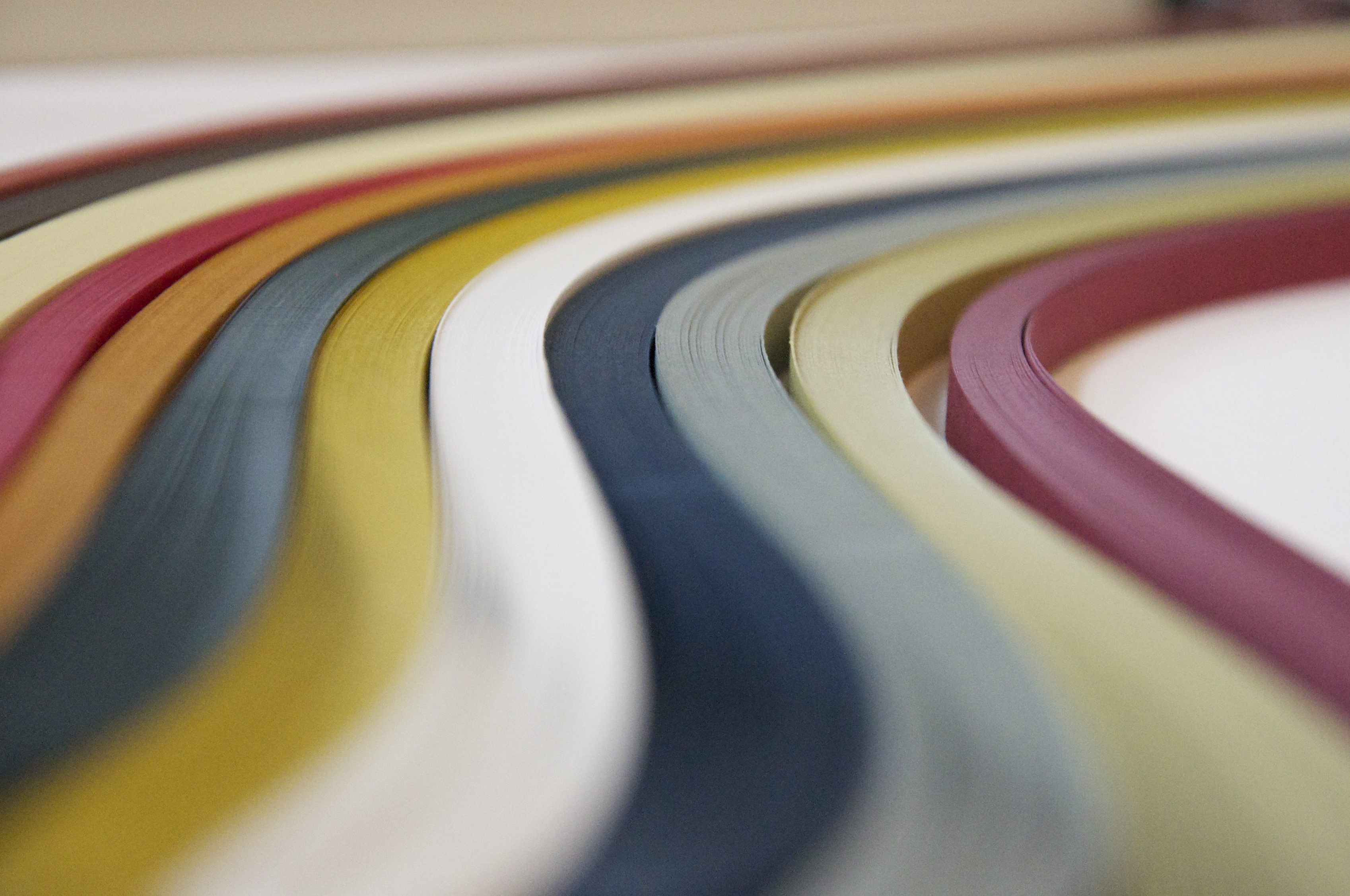 Image of multiple colored quilling paper strips