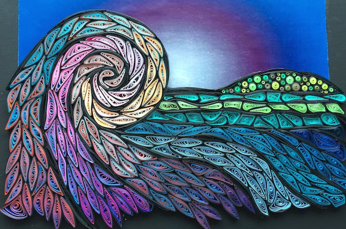 Image of quilled mosaic in progress on a colored background