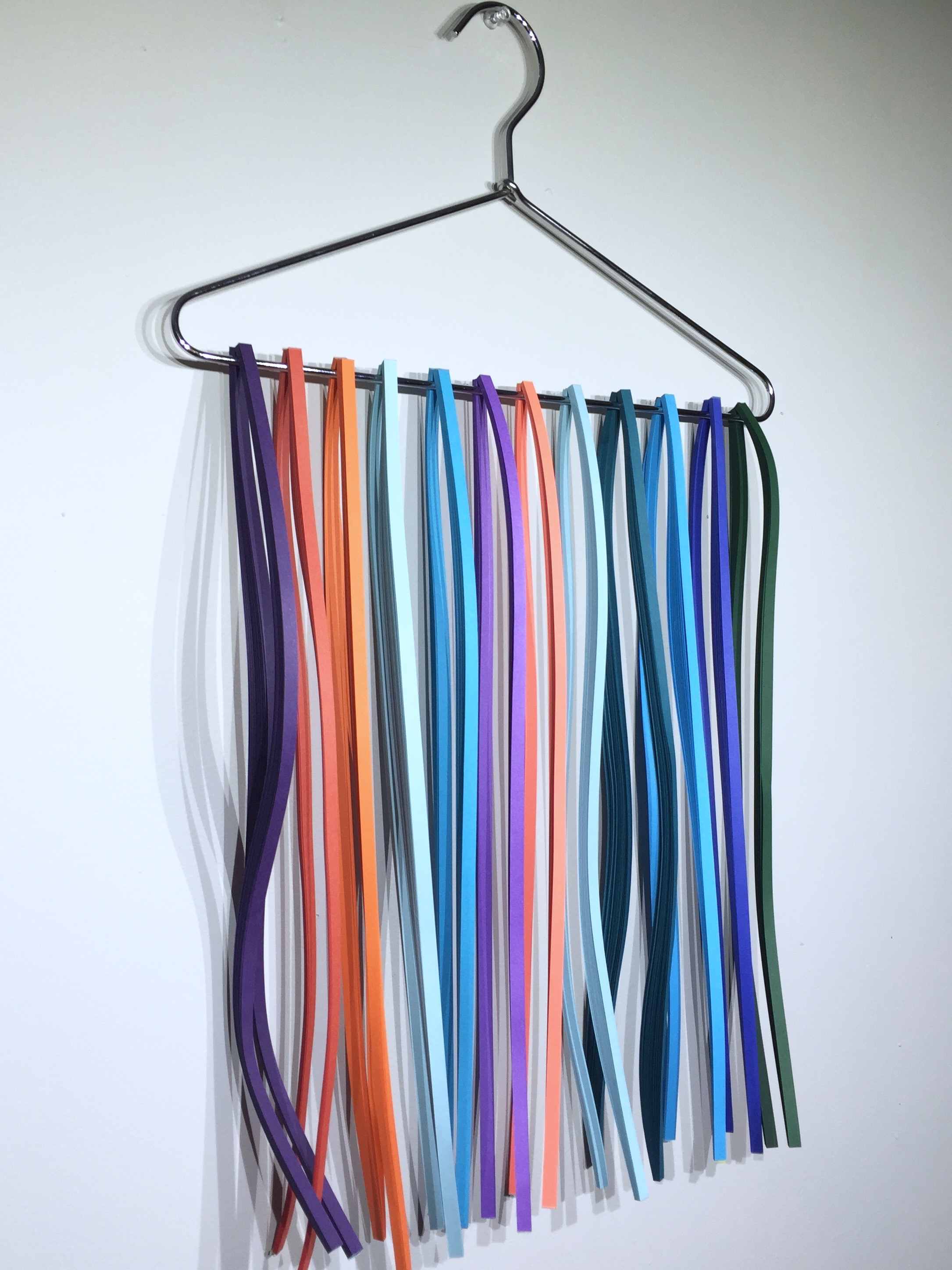 Image of storing quilling paper on a hanger
