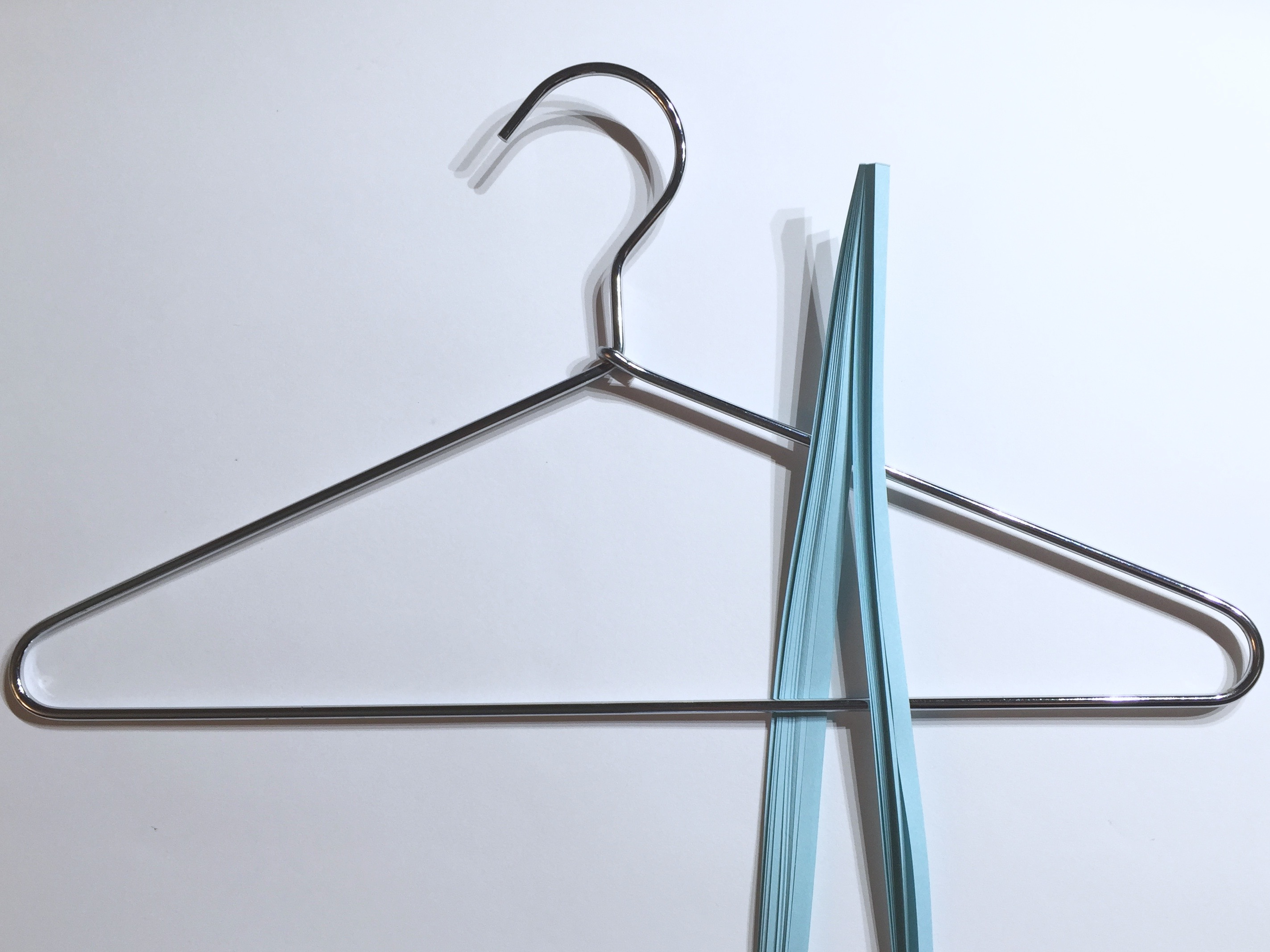 Image of draping quilling paper over a hanger