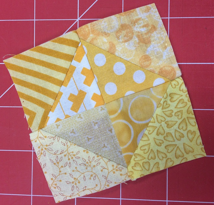 Sew four triangle squares together