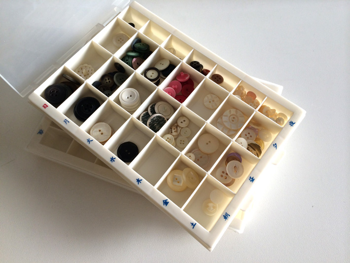 Buttons organized in pill trays - a sewing room organization hack