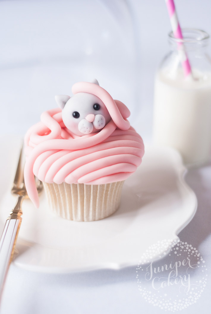 Decorate your cupcakes with cute fondant toppers like this sweet kitty cat cupcake via Juniper Cakery