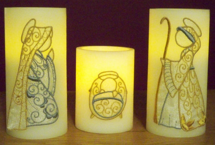 lit nativity embroidery candle