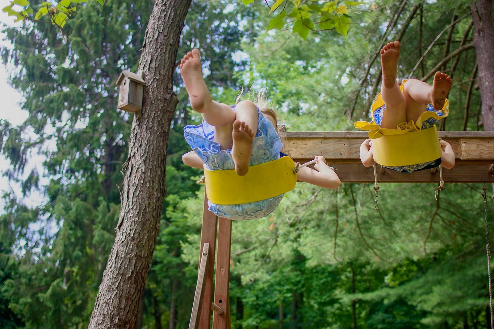 girls on swings, legs, summer
