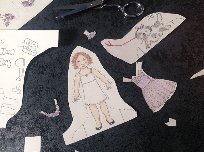 how to cut out a paper doll
