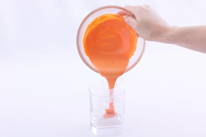 Pour orange chocolate into bag