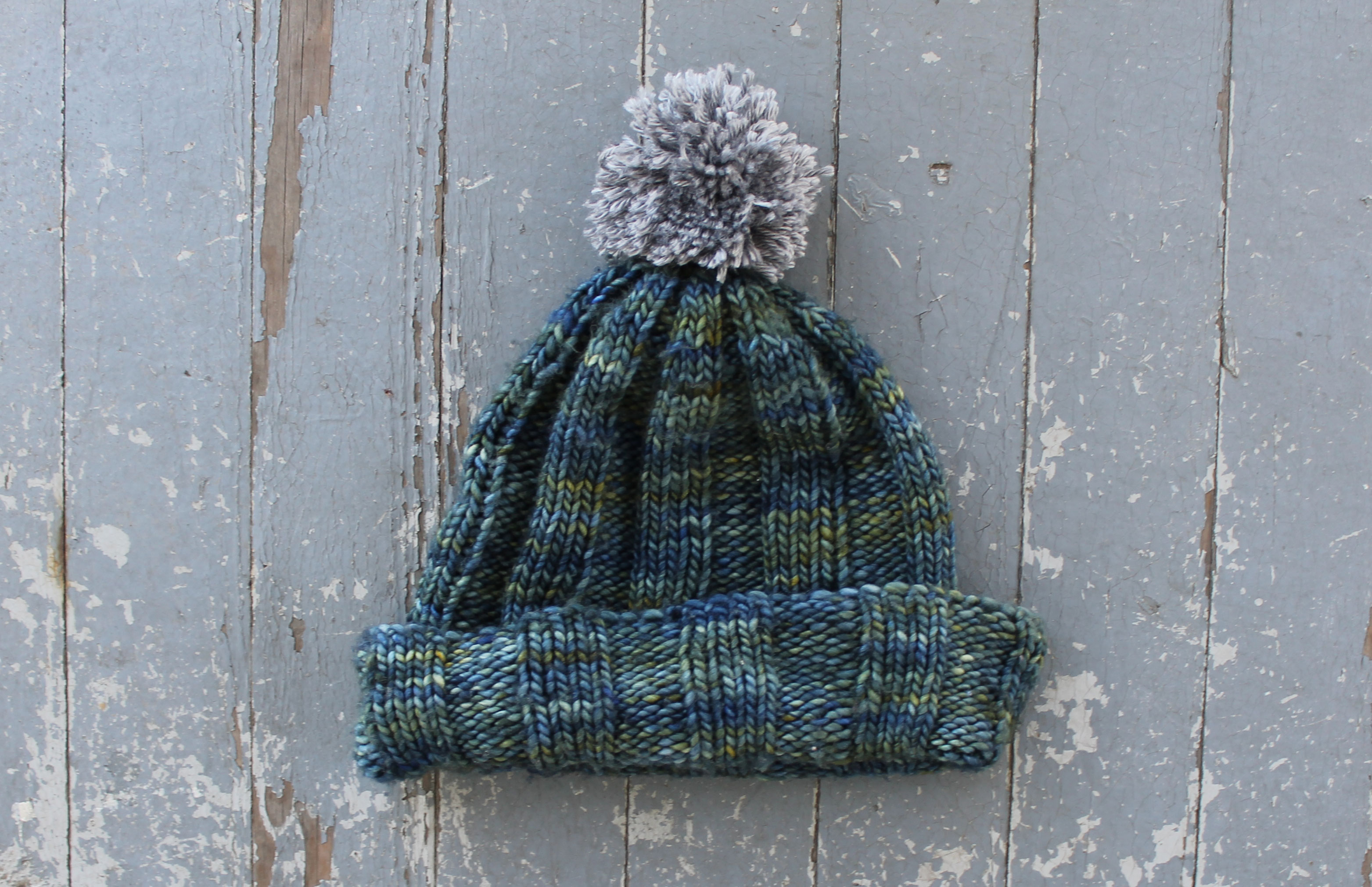 Knit hat with a yarn pompom