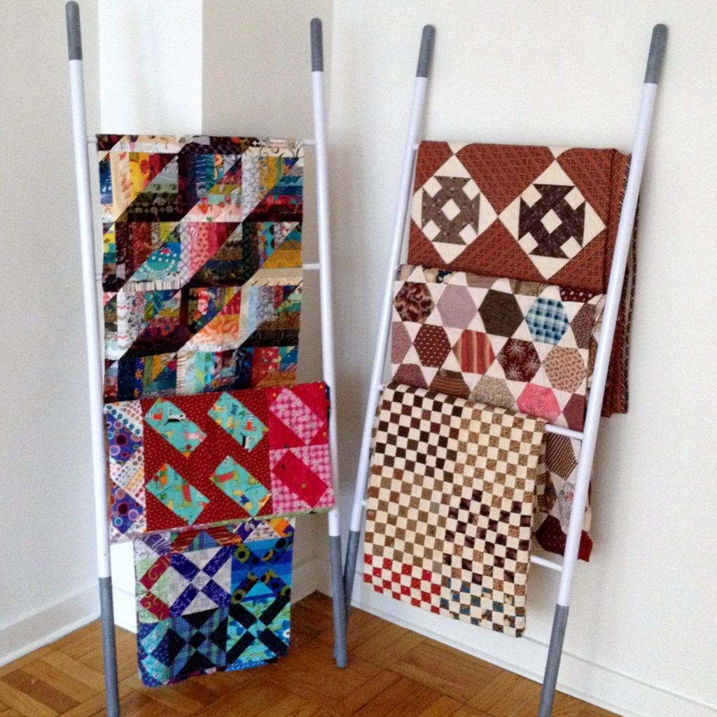Quilts Displayed on Ladders