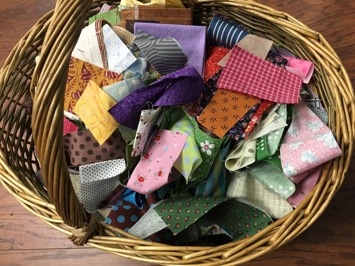 basket of larger quilt fabric scraps and strips