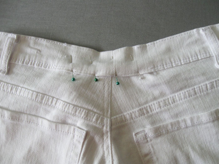 sew waistband back on the jeans and topstitch